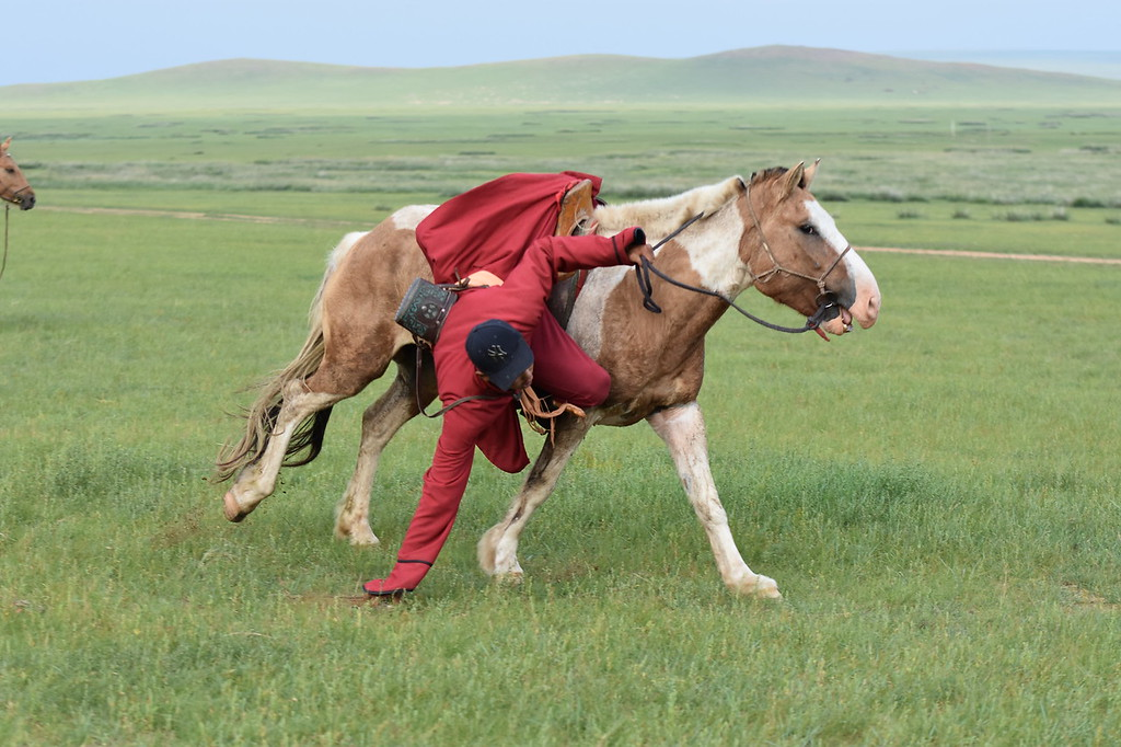 Herdsman from the Gobi Desert Cup demonstrating horsemanship.